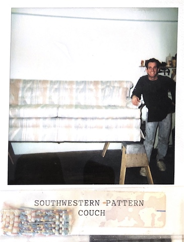 Owner of Vegas Upholstery standing next to a reupholstered couch
